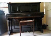 Upright black mahogany family piano and piano stool