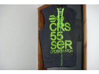SIZE MEDIUM CROSSHATCH DARK GREY GILLET WITH GREEN WRITING ON FRONT