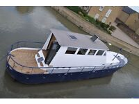 Houseboat - 52 foot ex Sea Plane Refueller on residential mooring in East London