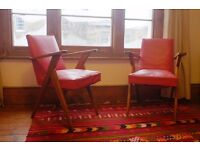 x2 red mid-century lounge chairs