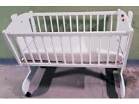 Cot bed swinging system