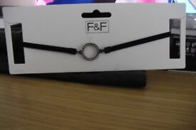 BRAND NEW BLACK CHOKER NECKLACE WITH CIRCLE OF CLEAR STONES