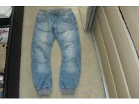 PAIR SIZE 32R MEN'S CROSSHATCH JEANS WITH CUFFS AT THE BOTTOM