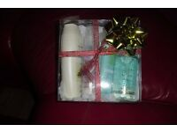 NEW AVON PAMPER GIFT SET INCLUDES VARIOUS ITEMS IN CLEAR PLASTIC BOX WITH RIBBON