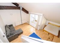 Plate House - A lovely split level studio apartment set within this converted warehouse building