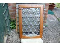 Cupboard doors, leaded glass fronted, oak framed with brass handles