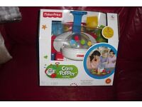 NEW FISHER PRICE CORN POPPER GAME 2 GAMES IN 1 FOR AGES 2+