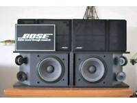 Bose speakers in fully working order and with covers