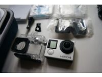 GoPro Hero 4 Silver Camera with accessories and a free Lowepro camera bag