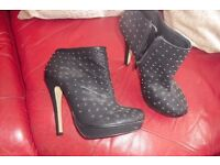 """SIZE 7 PAIR OF BLACK SHOE BOOTS WITH 5"""" HEEL WITH GOLD STUDS ON"""