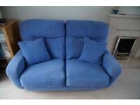 Two seater sofa in blue cloth material.