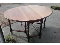 Drop leaf oval oak table