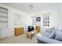 Light 2 dbl bed flat in a secure gated development with communal gardens. Vicarage Crescent SW11