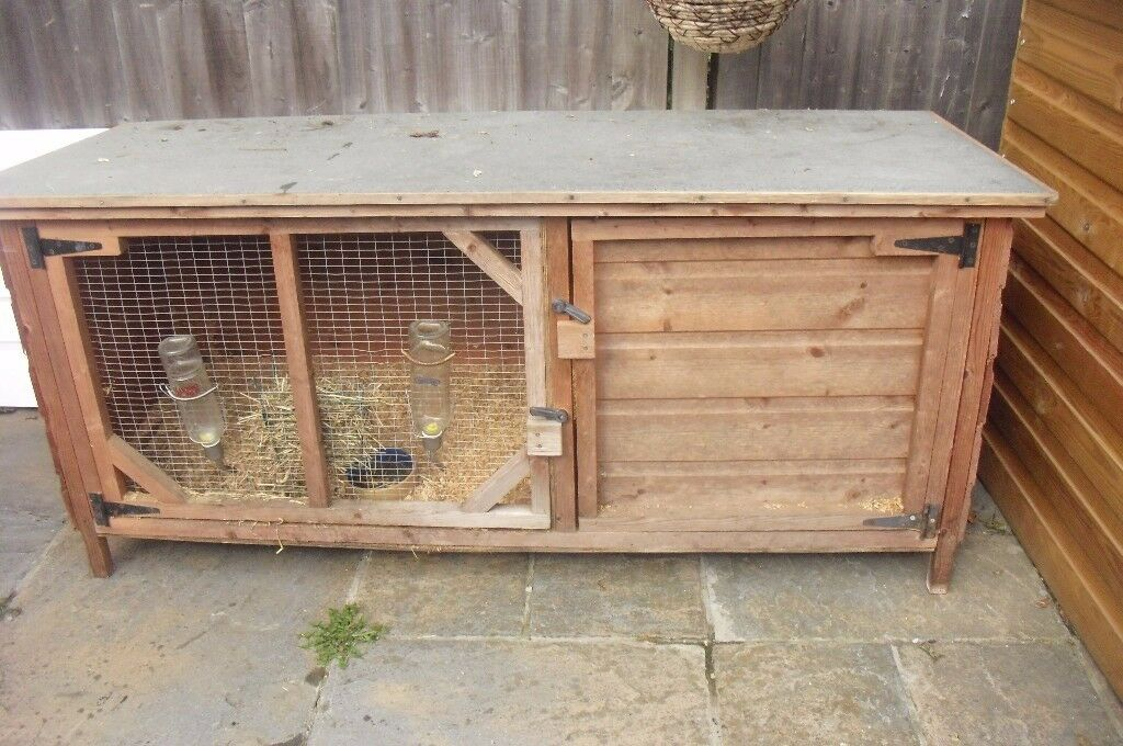 "VERY LARGE RABBIT HUTCH LENGTH 64"" IT'S IN EXCELLENT CONDITION"