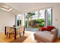 A BEAUTIFUL FOUR BEDROOM FAMILY HOME WITH FABULOUS EAT IN KITCHEN & DECKED GARDEN ON ALFRISTON ROAD