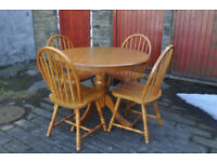 beech pedestal round table and four chairs