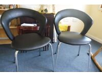 Two Black Faux Leather Chairs with Chrome Legs