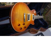 Les Paul standard with the best flame top ever! Revelation Blues line with re-sliced headstock