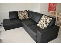 Corner sofa in black leather