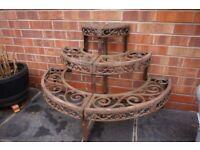 Ornate metal garden pot stand