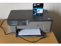 HP Deskjet 3070A multifunction printer with spare black ink