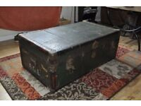 Large travelling trunk used as a blanket box
