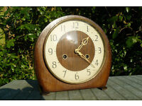 Clock. Wood, made by smith's and in working order. 8 day, chimes hourly and half hourly.