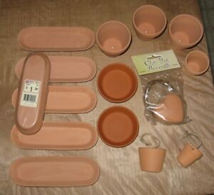 15 small clay pots of different shapes