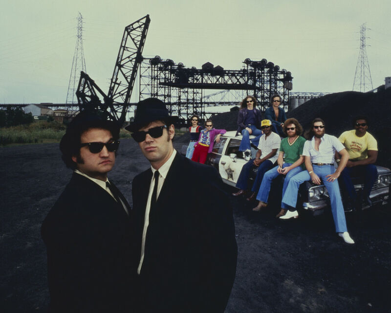 The Blues Brothers Dan Aykroyd John Belushi posing by police car 8x10 Photo