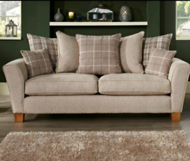 Beige three seater fabric couch