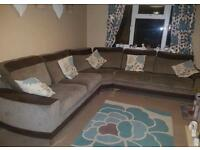 Extremely large corner sofa and pouffe