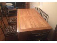 Solid Oak extending table.