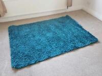 Next teal long pile rug 120x170