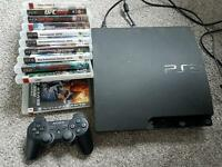 Sony ps3 with games and controller