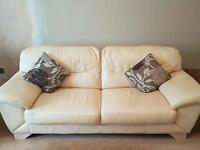 Cream three piece suite with pouffe