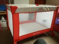 Travel cot spotty and red
