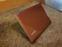 Slim Red Advent E100 Laptop