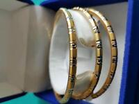 Lovely 3 bangles 21 ct yellow gold