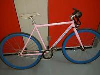 Create pink fixie bike with blue wheels