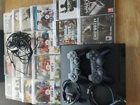 Playstation 3 2 pads 20 games and ear peace