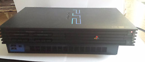 PS2 + 2 controllers + 1 memory car + 5 games of your choice