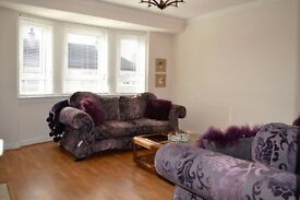 purple floral 3 + 2 seater as new