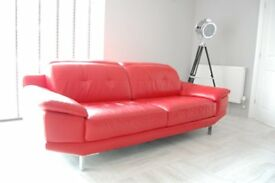 Stylish red leather suite comprising matching three and two seater sofas