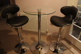 Glass top table with 2 adjustable bar stools
