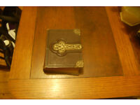 Vintage small photograph album with gold leaf edging .