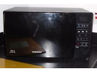 Samsung ME731K black microwave oven less than 12 mths old cost £80