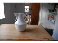 White tall large handled jug with decorative beading around centre.