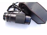 Tokina A-TX zoom lens. 35 – 200mm. 1:35 – 4.5.