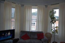 cream curtains for bay windoow