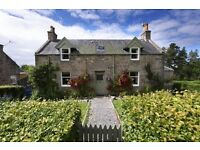 Charming Victorian school house with large adjoining school building in rural village.